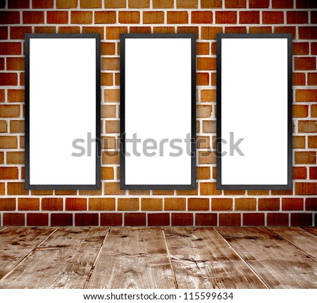 Empty grunge brick wall  interior room with empty wood frames and wooden plank floor
