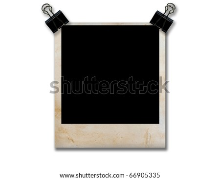 empty grunge photo frame with black clip isolate