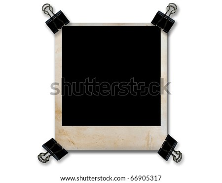 empty grunge photo frame with 4 paper black clip isolate