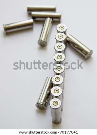 Empty gun cartridges on white background.