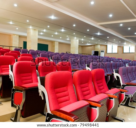 Empty hall for presentation with red and purple armchairs