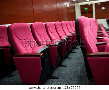 Empty hall for presentation with red armchairs. #128677022