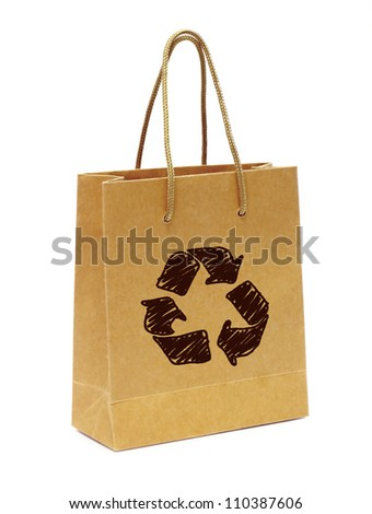 Empty hand  bag from recycle paper with recycle sign on white