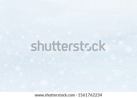 Empty hand drawn light blue winter background with falling snow, universal basis for design