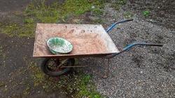 empty handcart in the garden of the house