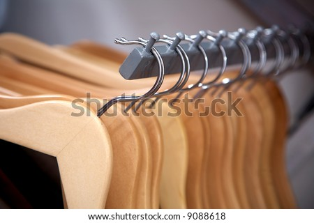 empty hangers in a row at a retail store