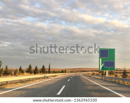 Empty highway and highway sign #1362965330
