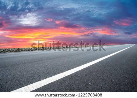 Empty highway asphalt pavement and sky cloud landscape #1225708408