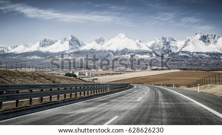 Empty highway D1 and snowy peaks of High Tatras mountains, Slovakia