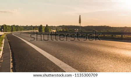 Empty highway during sunset, low angle view #1135300709