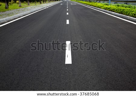 Empty highway with road signs arrows on asphalted surface