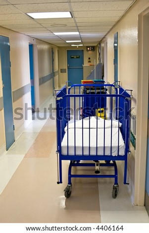 Empty hospital corridor and bed for babies