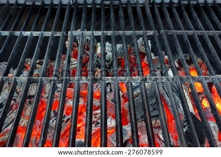 Empty Hot Barbecue Cast Iron Grill With Glowing Charcoal Background #276078599
