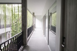 Empty hotel hallway indoor outdoor. Vanishing point perspective.