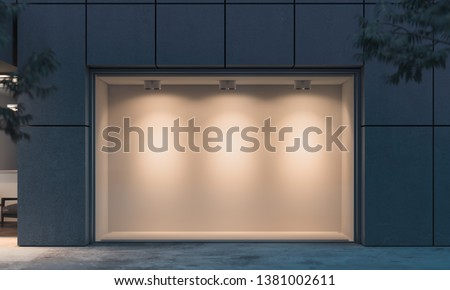 Empty illuminated storefront. night time. 3d rendering. Copy space. Empty space.