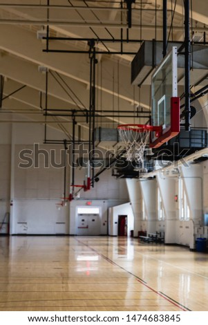 Empty indoor basketball court gymnasium with baskets and nets