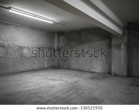 Empty industrial garage room interior with concrete floor and wall background