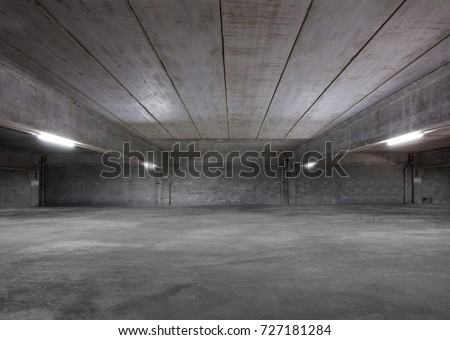 Empty Industrial Shed or Parking Lot. Urban, Rough Under-construction Background. Empty Warehouse Interior.