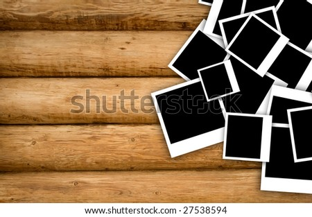 Empty instant photos on grunge wood background.