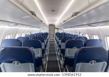 empty interior of the passenger aircraft #1398361952