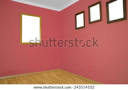 empty interior with wooden floor, frames on wall and pale red wall