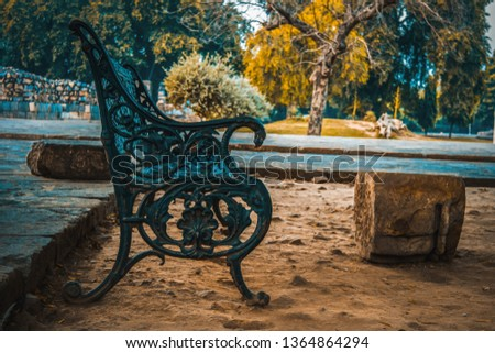 empty iron Chair somewhere in garden for Relaxing the people. peaceful area for couple.