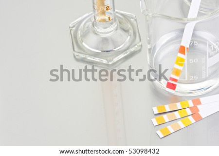 Empty lab chemical containers with PH indicator