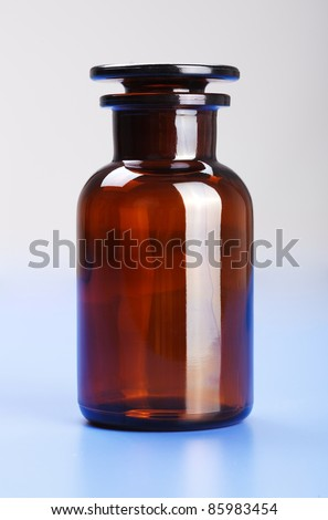 Empty laboratory glass chemical bottle shut with glass cap