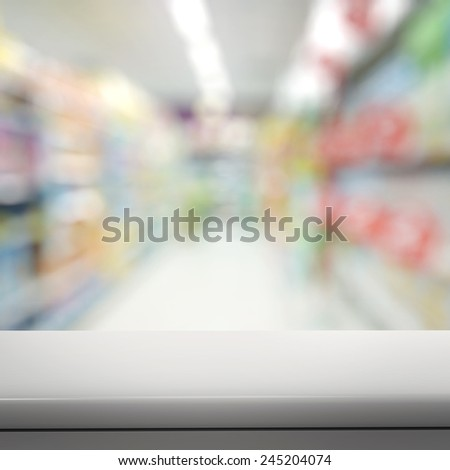 Empty laminate shelf and blurred  background for business product presentation