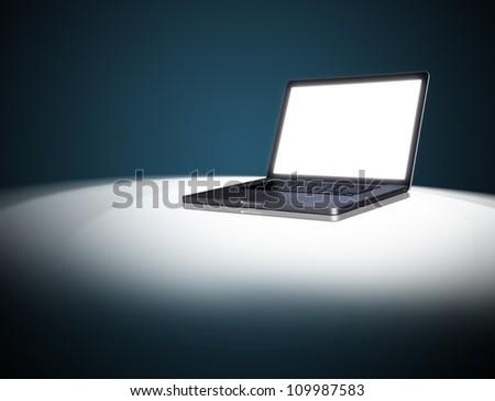 empty Laptop on dark background.