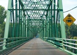 Empty large green 2 lanes metal bridge.