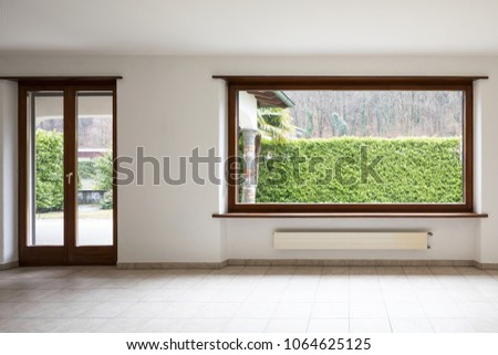 Empty large room with large windows. Very bright room without anyone inside
