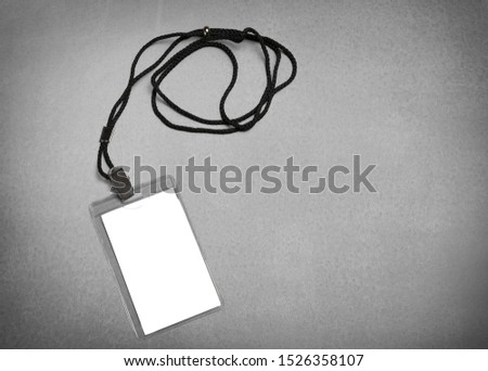 Empty layout layout. Common blank label name tag hanging on neck with thread. #1526358107