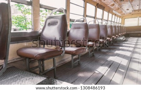 empty leather seat inside the vintage auto bus of bangkok metropolis, thailand transportation #1308486193