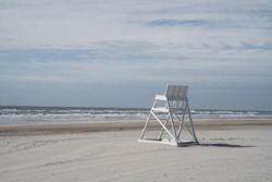Empty lifeguard chair, early morning, Avalon, New Jersey, summer vacation.