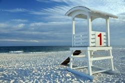 Empty lifeguard hut on deserted beach.