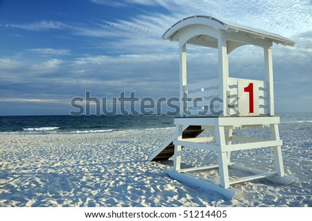 Empty lifeguard hut on deserted beach.
