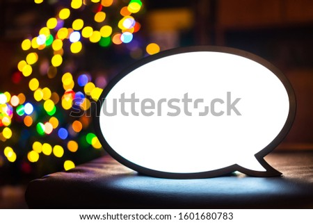 Empty lightbox sign with colourful bokeh balls in the background. Blank light box screen for adds, promotion, business advertising messages. Bright chat lamp with white screen for text