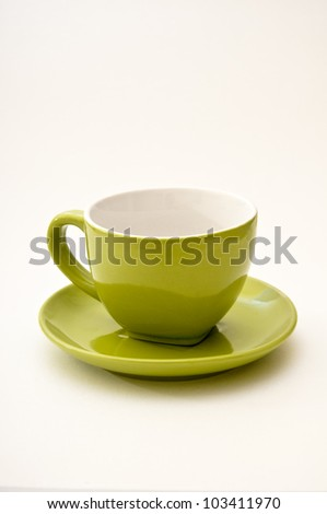 Empty lime green ceramic coffee mug with soft shadow