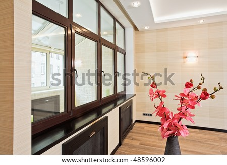 Empty living room interior in modern style with orchid flowers in wicker withe vase