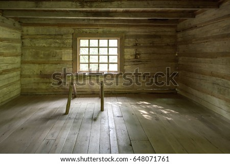 Empty Log Cabin Interior. Interior of a historic pioneer log cabin in the Smoky Mountains. This cabin is a historical display open to the public and is not a privately owned property or residence.