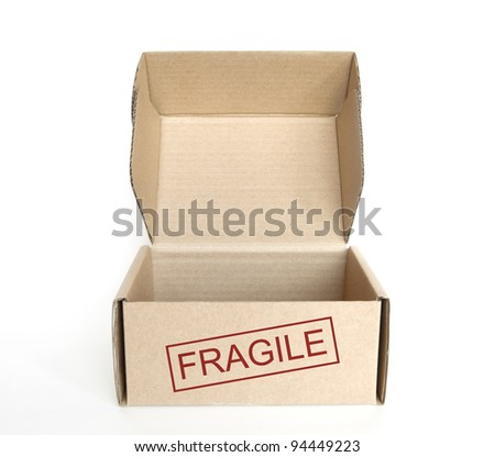 empty logistics cardboard box with fragile text on white background