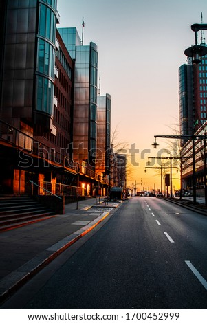 Empty lonely street view of downtown district with golden warm sunset light with buisness buildings. Historic and famous harbour district Speicherstadt and modern Hafencity  in Hamburg, Europe