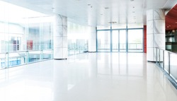 Empty long corridor in modern office building.