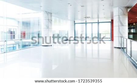 Photo of  Empty long corridor in modern office building.