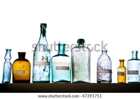 Empty magic bottles on white background