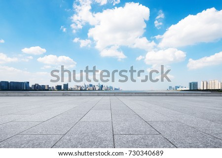 empty marble floor and cityscape of hangzhou in blue cloud sky #730340689