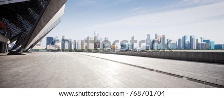 empty marble floor and cityscape of hangzhou qianjiang new city in blue cloud sky #768701704