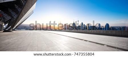 empty marble floor and cityscape of kuala lumpur at sunrise