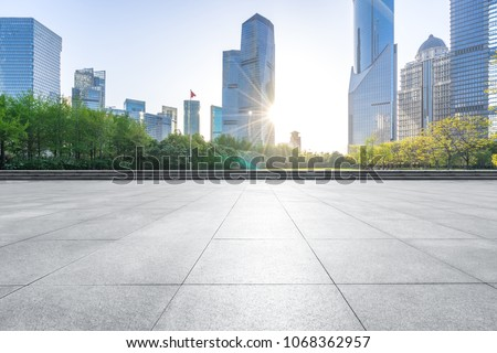 empty marble floor with modern building #1068362957
